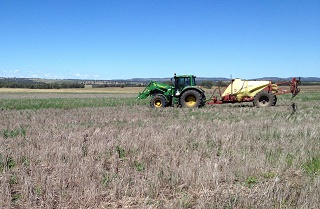 Spraying weeds in a summer fallow 320p